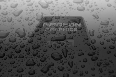High definition AMD Radeon background rained on in black and white.