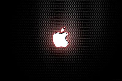 High Def desktop background with chrome Apple logo on metal grate.